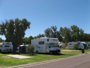 Shady grassed caravan and camping sites at Arno Bay Caravan Park.